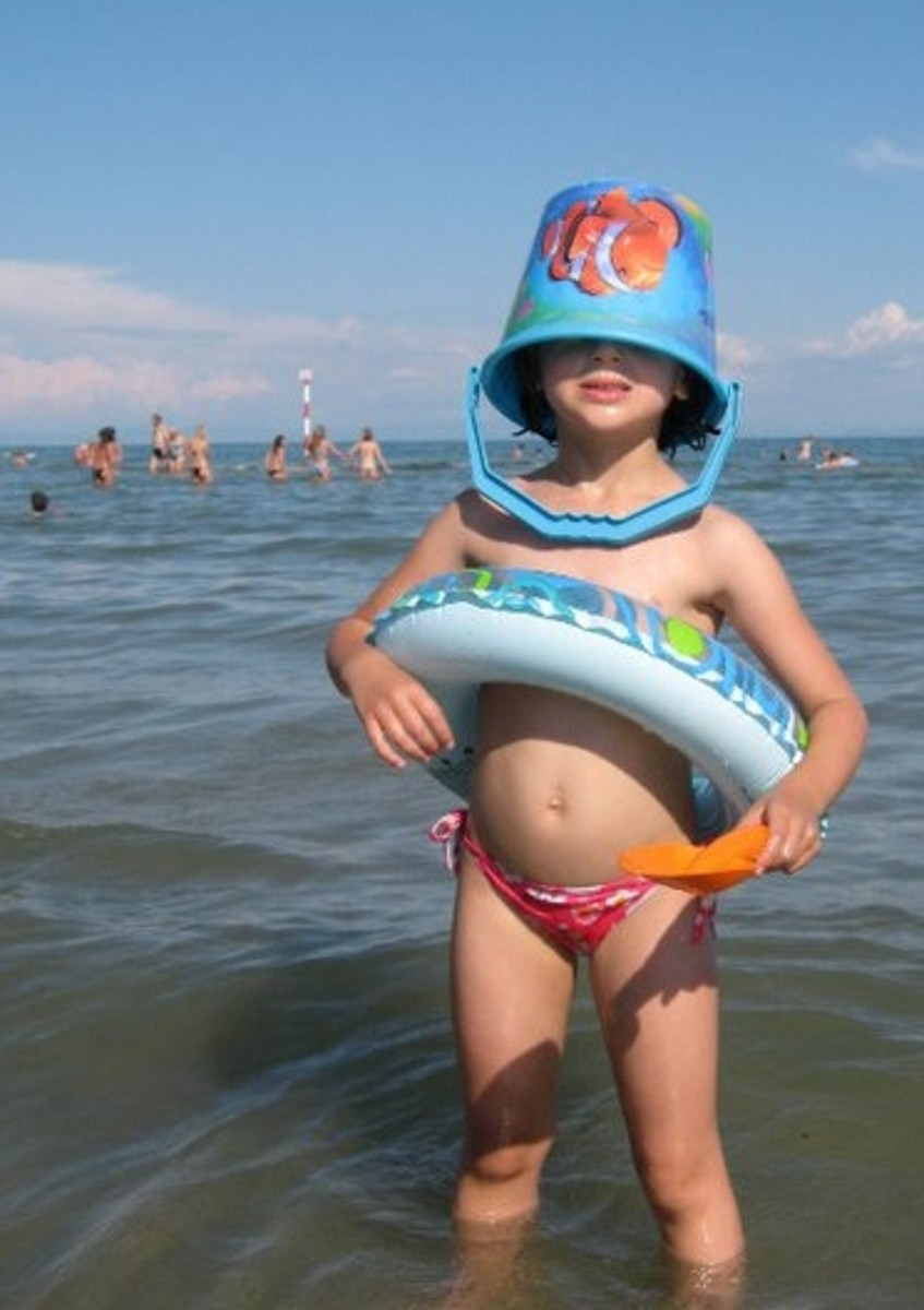 Lignano Sabbiadoro, having fun in the shallow sea water