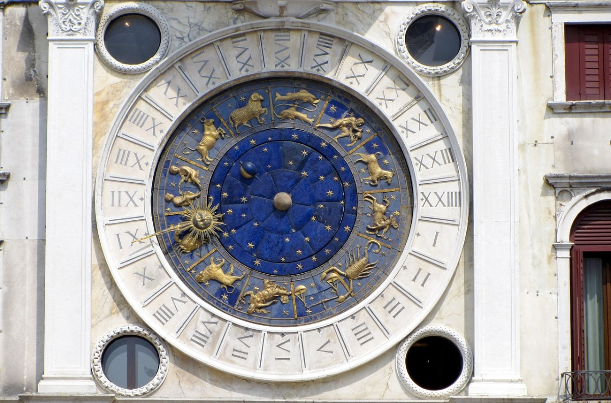 A close-up of the clock on the tower.  Note the astrological symbols and the moon phases.