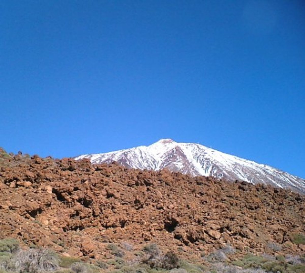 Mt Teide's snow-capped peak and red volcanic rock
