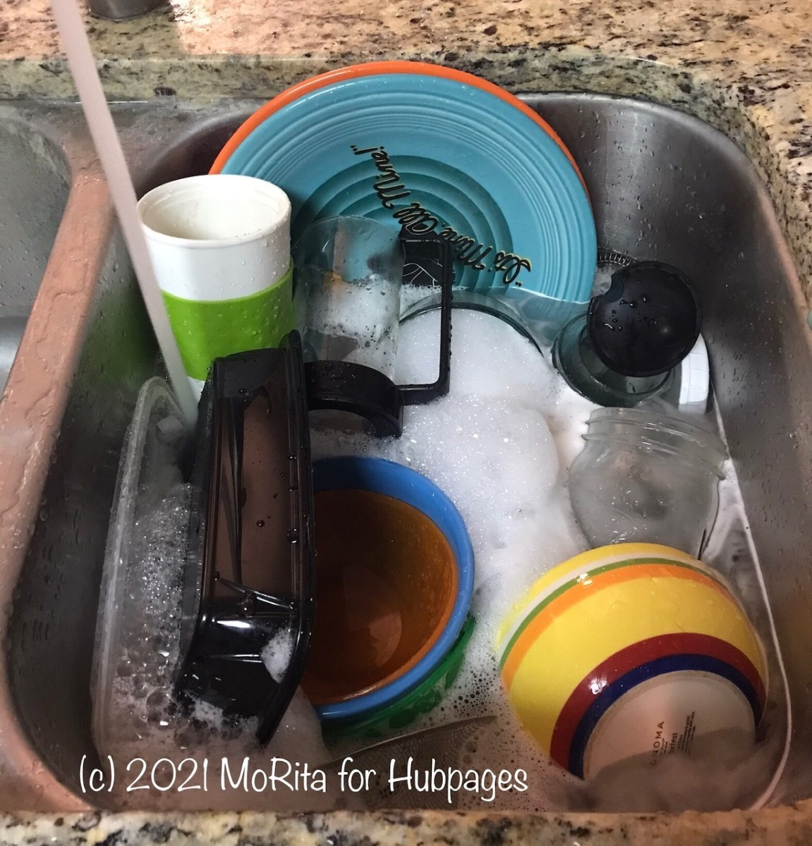 Filling the storage sink with soapy water