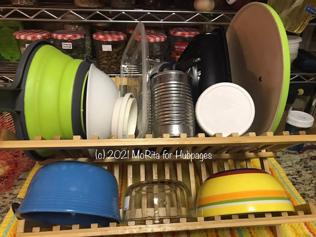 A folding bamboo dish rack holds a lot of dishes and can be folded up and stored when not in use.