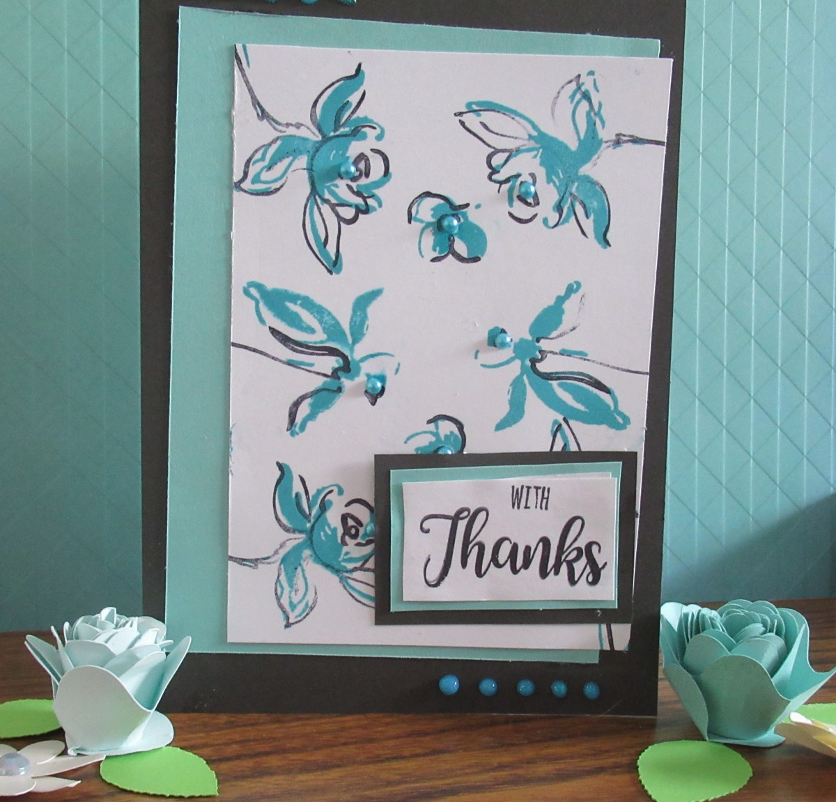 This is a layered stamped standard fold greeting card