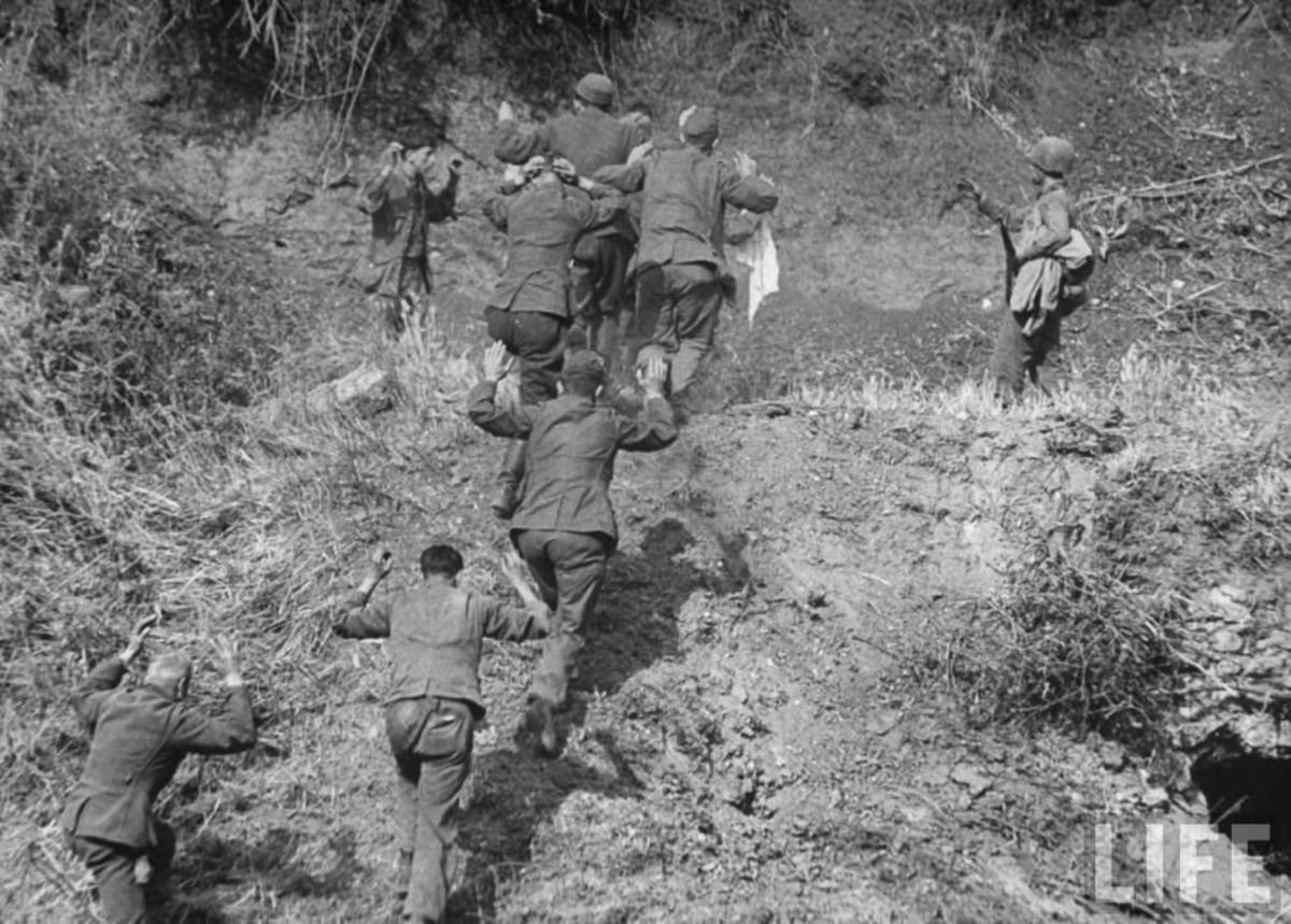 The 3rd ID taking exhausted and hungry Germans prisoner. Note the steep terrain of the Caesar Line.
