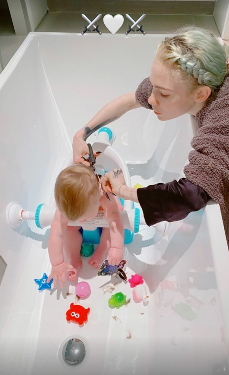 Grimes shared this photo on Instagram of her giving her son a haircut