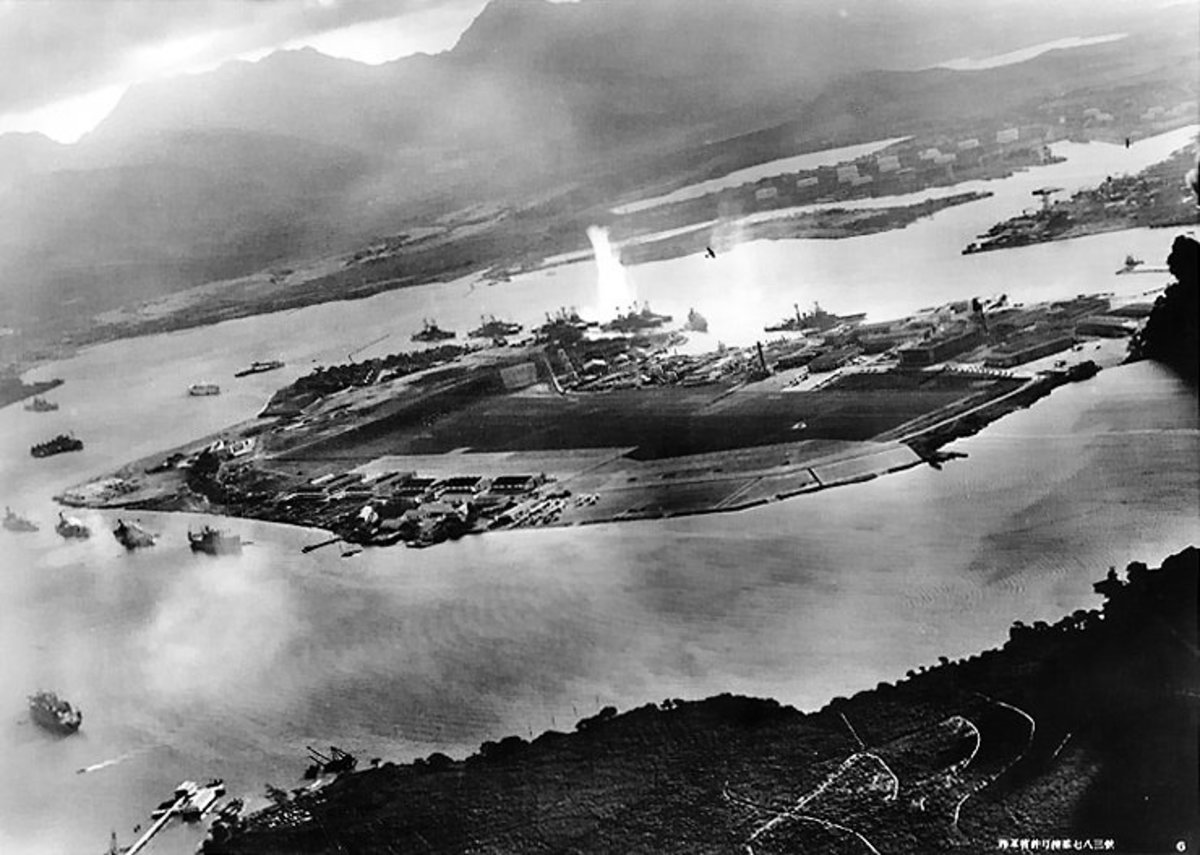 "Japanese caption: ""Full view of Ford Island gasping under the attack of our Sea Eagles."""