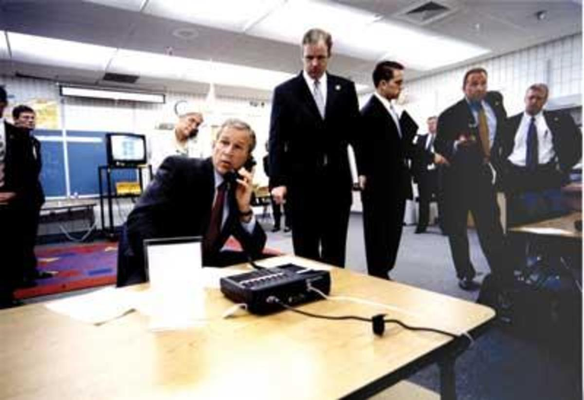 President Bush being briefed in WTC attacks.