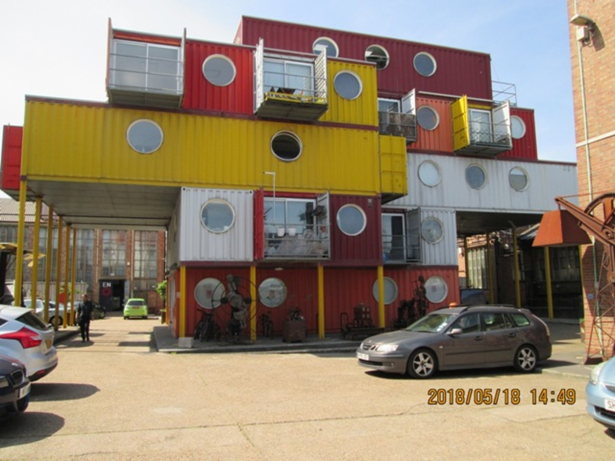 """Look to your right at """"Container City #1"""" - #2 is behind. There are several pieces of unusual art around (the wharf now houses an artists' colony and school, the Parkour Academy"""