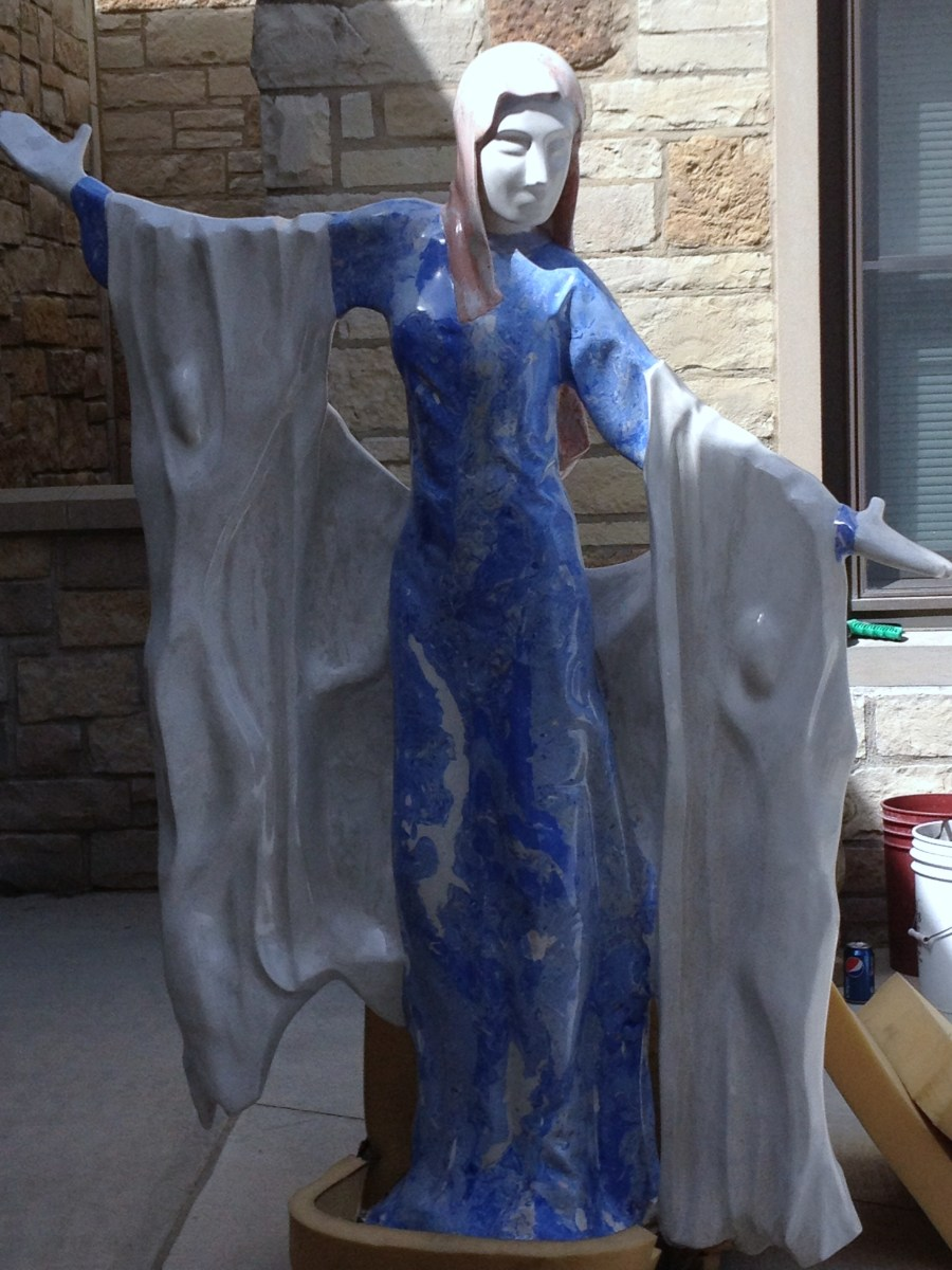 Greg's latest artwork, The Virgin Mary, is featured at the local catholic church.  Do you see the angels in the design?