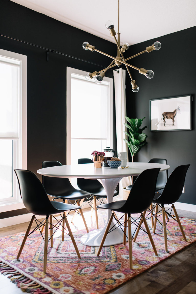 Love a good modern dramatic black dining room. The black painted room in done right!
