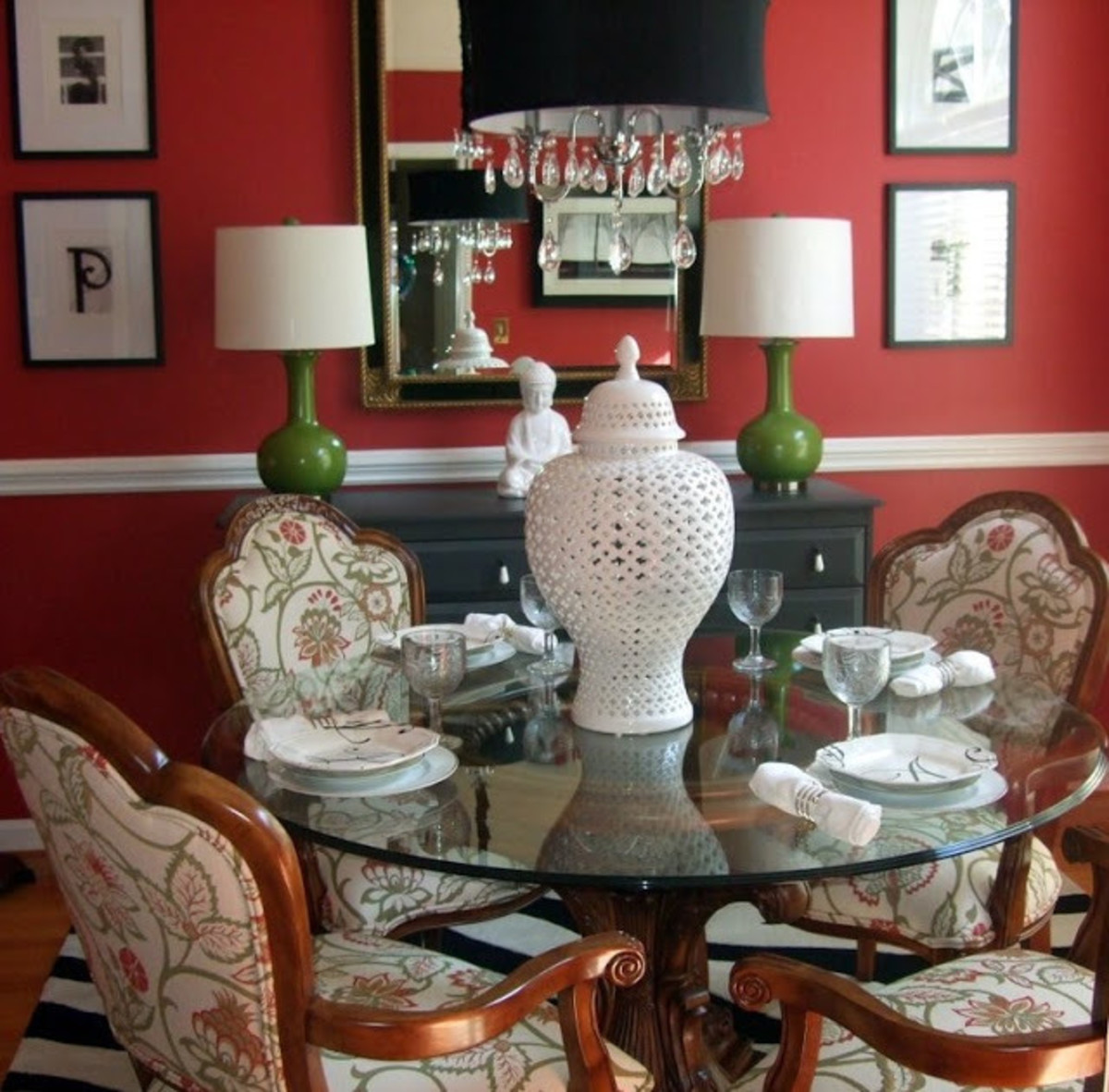 The crimson beautiful dining room with the glass table and the upholstery chairs.