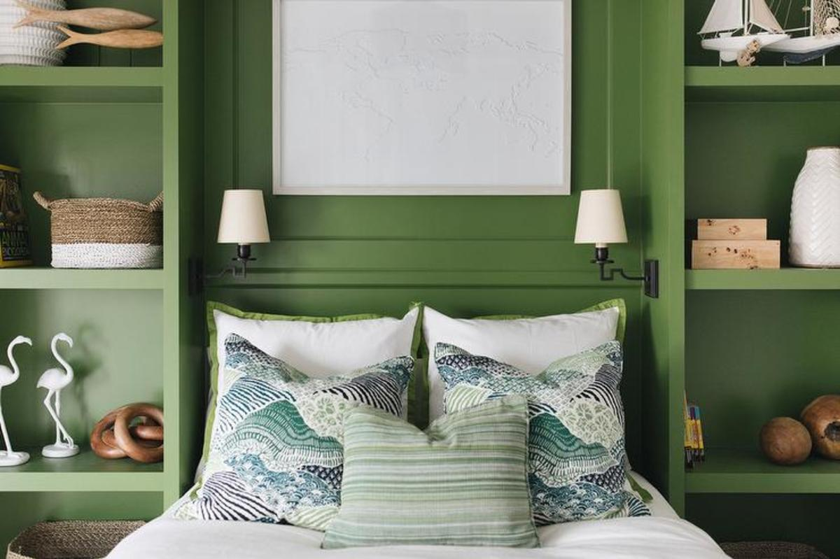 The green courtyard  is built-in shelves for the headboard. Green built In shelves flanking the bed.