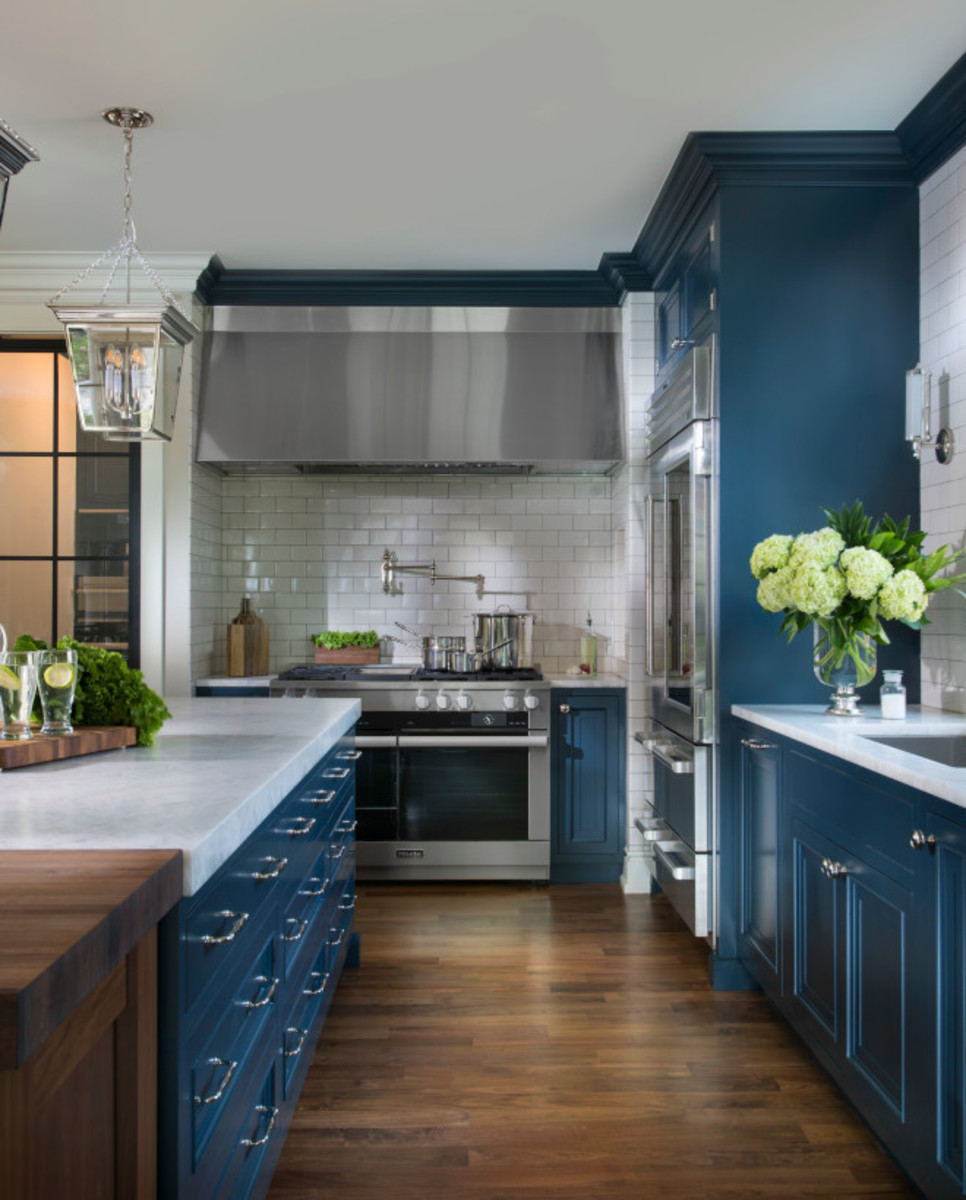 The cabinet details. The kitchen features custom doors with navy blue paint.