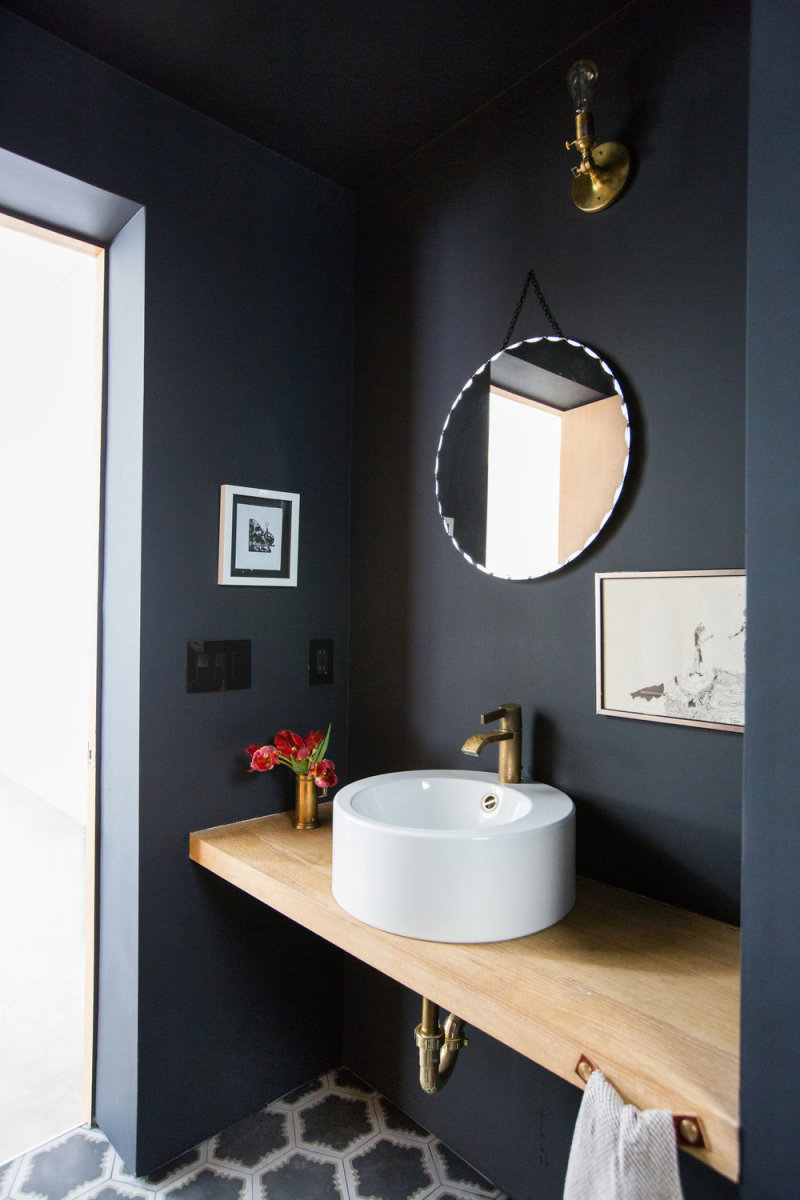 It's going for a bold look in this powder room.  Black lends a sophistication