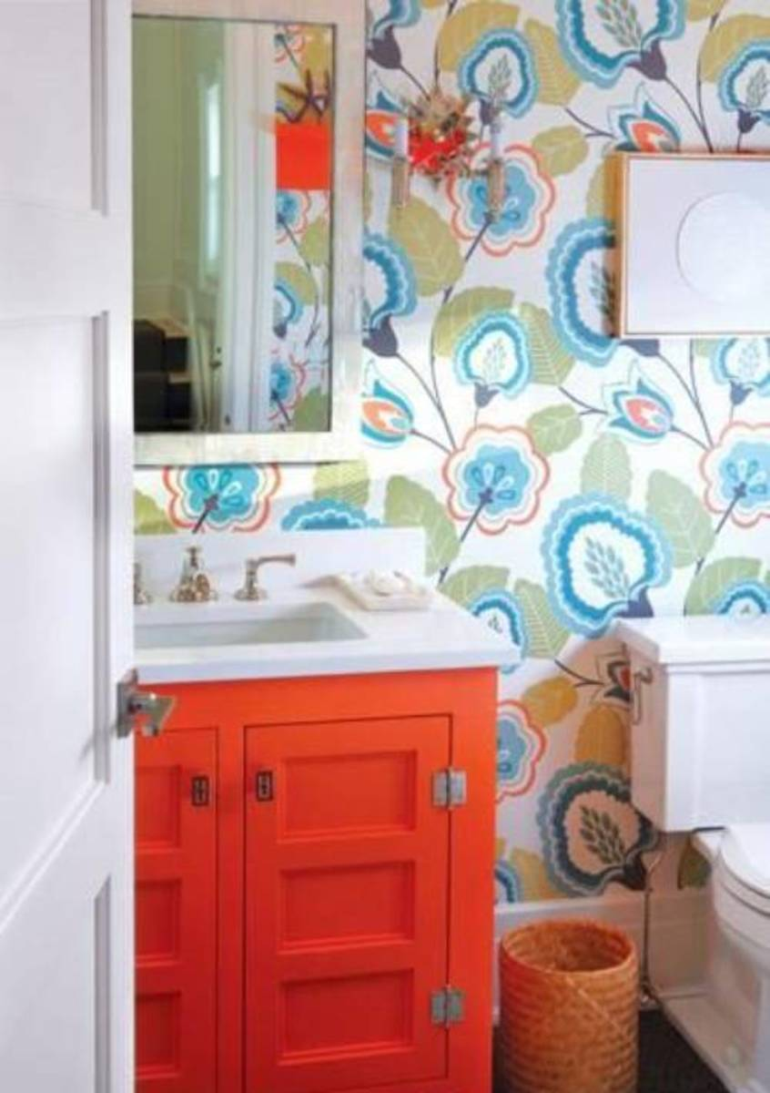 The small vanity is a bold color, like this orange bathroom.