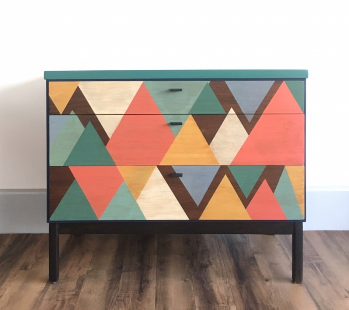 Fun and functional, this three drawer dresser geo with color and style!