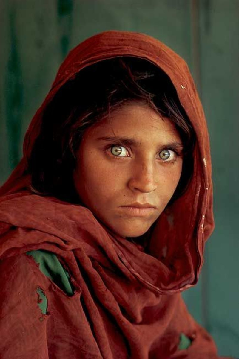 """""""The Afghan Girl"""" AKA """"The Afghan Mona Lisa"""" by Steve McCurry first appeared on the cover of National Geographic in June, 1985. It's now one of the most recognizable photographs in the world."""