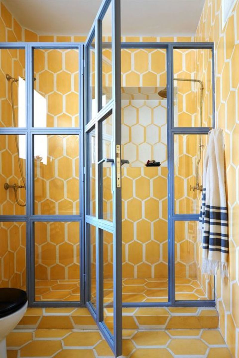 The tile in this bathroom looks like eggs, which is appealing to the Chinese Zodiac Rooster. Yellow is also a good color for this sign. They like big glass doors for their showers.