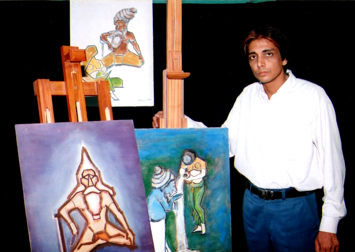 "Kamal with his philosophical paintings, highlighting ""Yoga and Maya"""