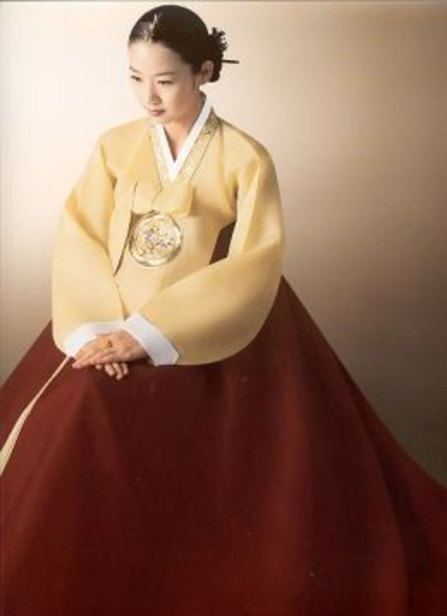 Lady wearing a color yellow and red Hanbok dress.