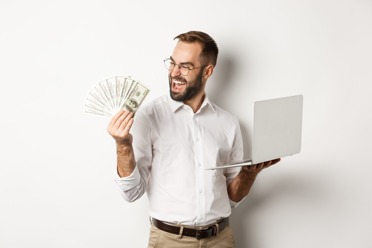 Just a happy guy waving his cash.