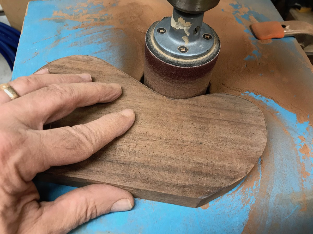 Smoothing out the edges with a drill press and a sanding drum