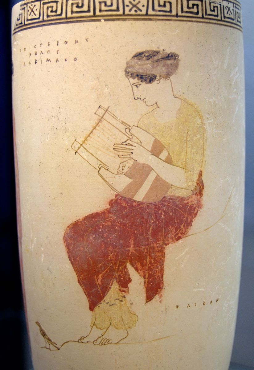 A Greek vase with a muse playing a type of lyre.