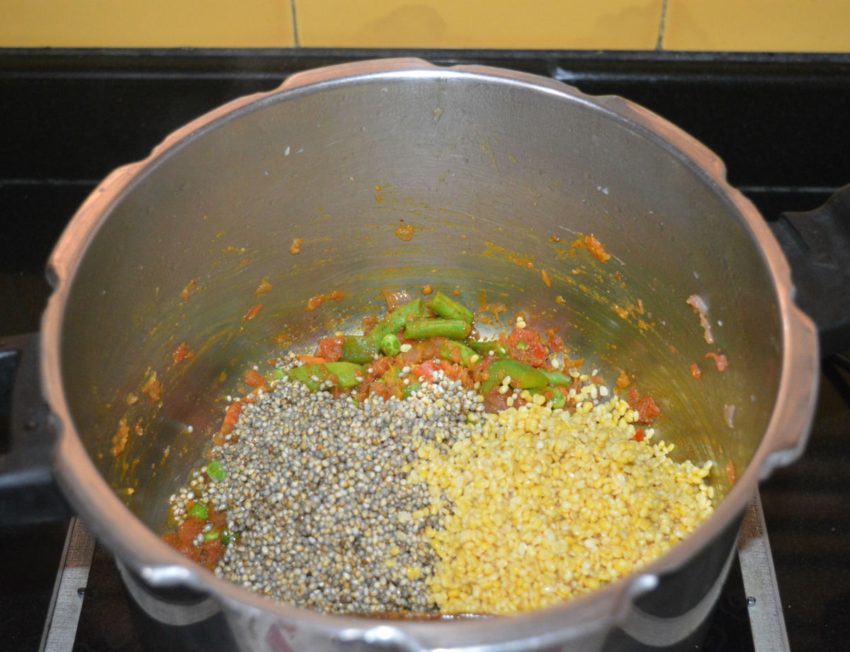 Step three: Add pearl millet and moong dal.