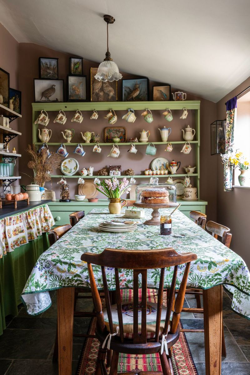 Cottagecore. Become familiar with the word if you want to design your home around the Chinese Zodiac Dog. This kitchen perfectly mixes green and red, by the way.