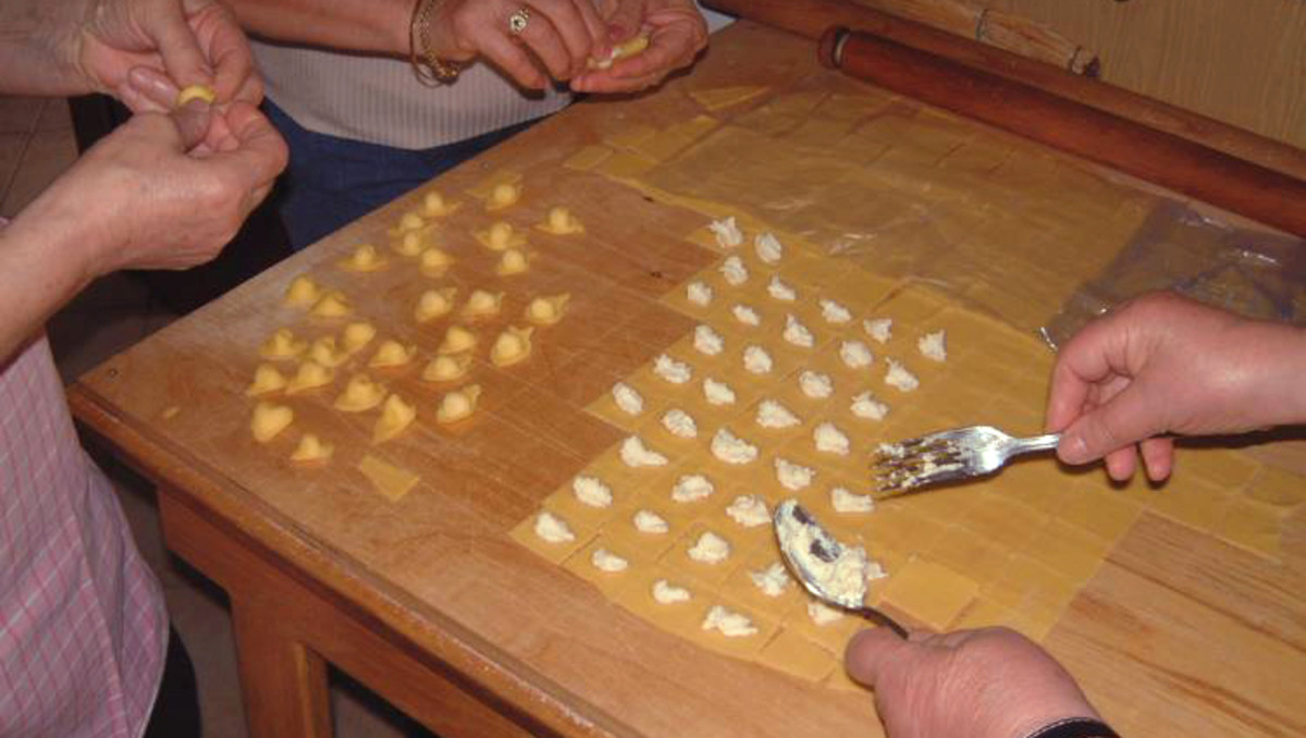 Cappelletti (Emilia Romagna). Made by stuffing squares of egg pasta, folding them in a triangle, and then joining the two ends around a finger. They are cooked in chicken broth and eaten as soup.