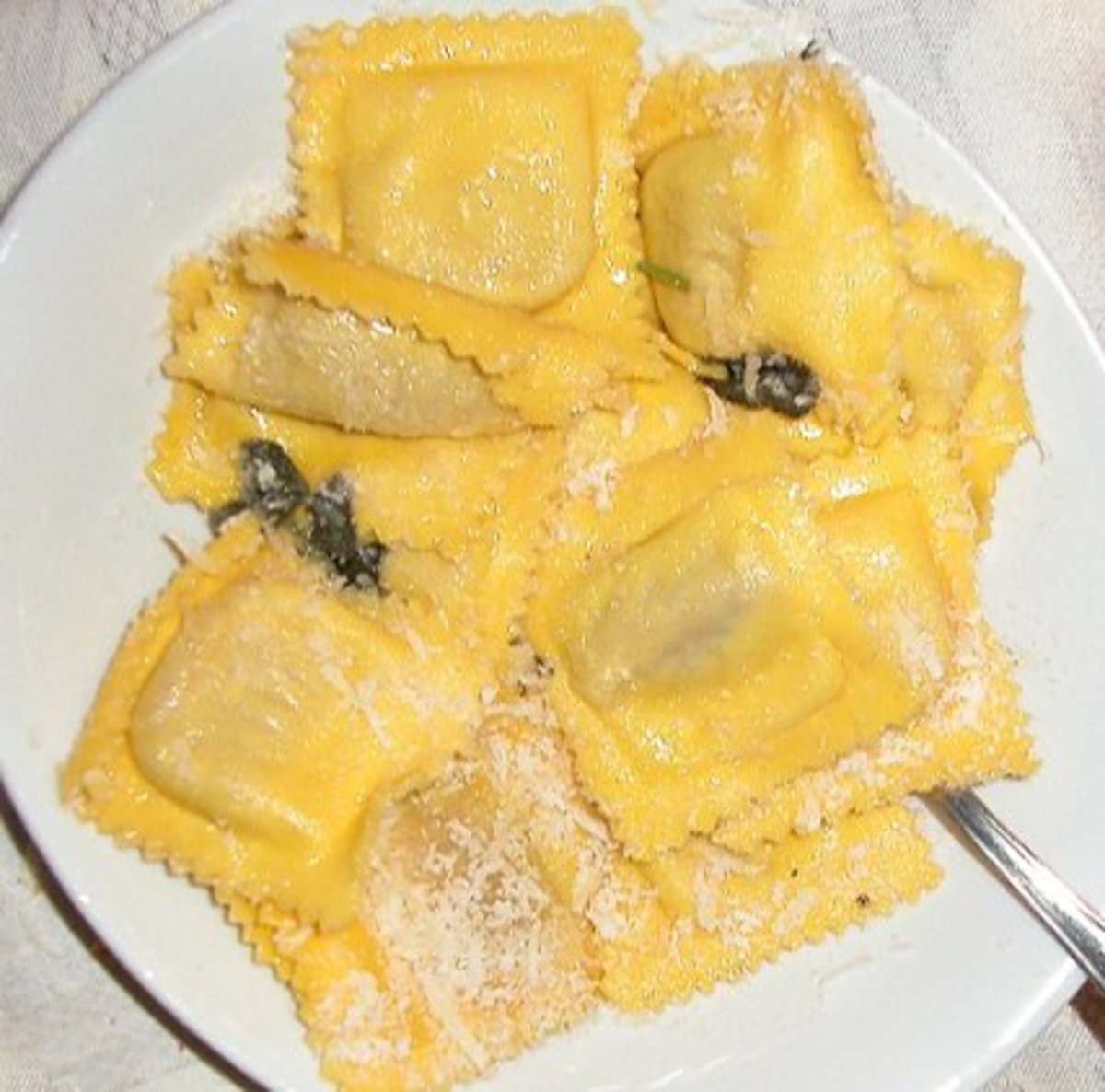 Tortelli with pumpkin stuffing, seasoned with Butter and sage. Tortelli di Zucca con Burro e Salvia.