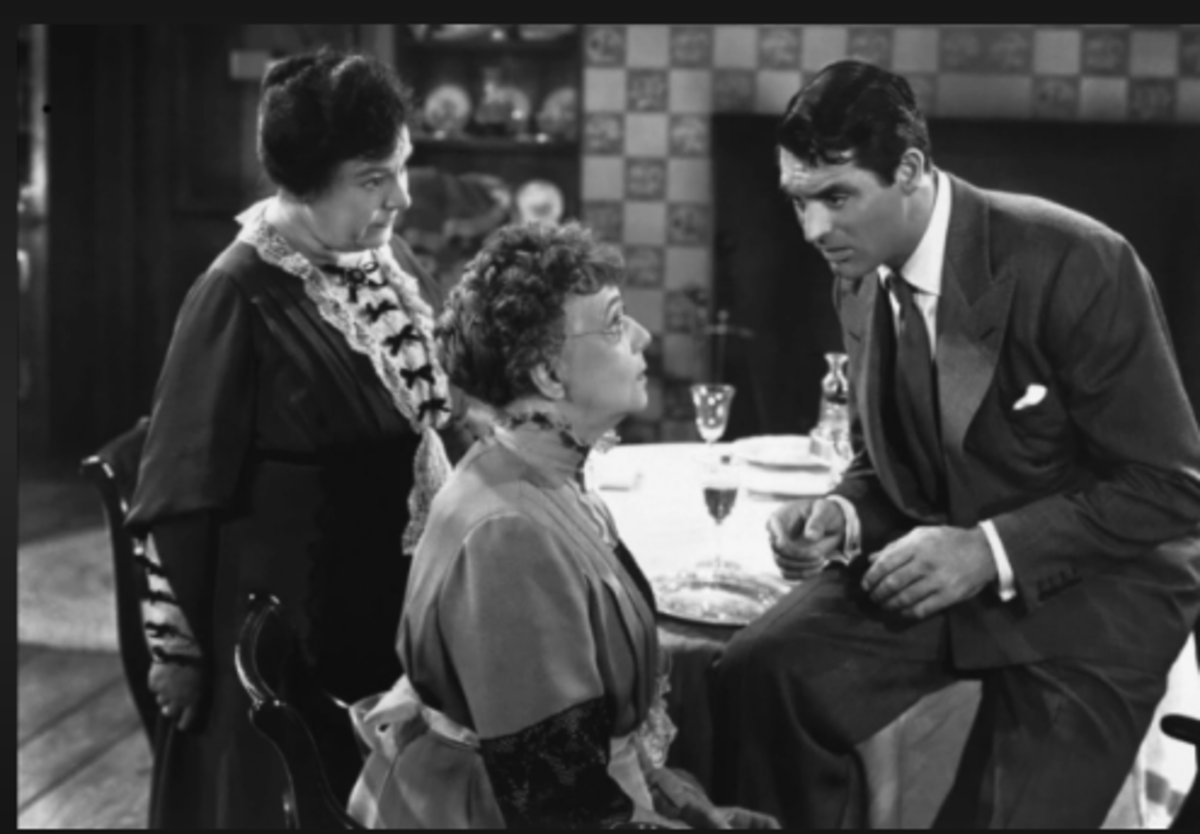 Cary Grant talking to Jean Adair and Josephine Hull