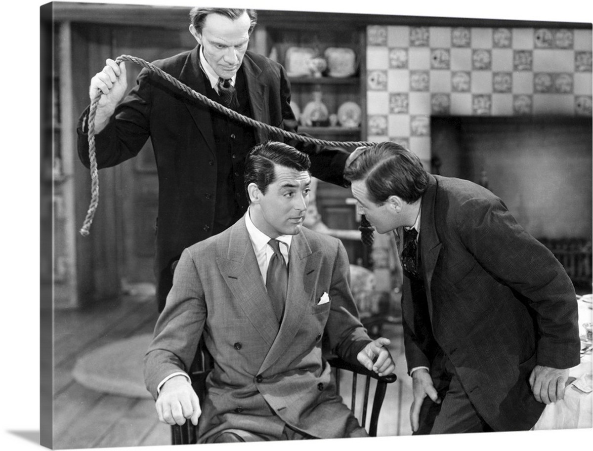 Raymond Massey and Peter Lorre ensnaring Cary Grant