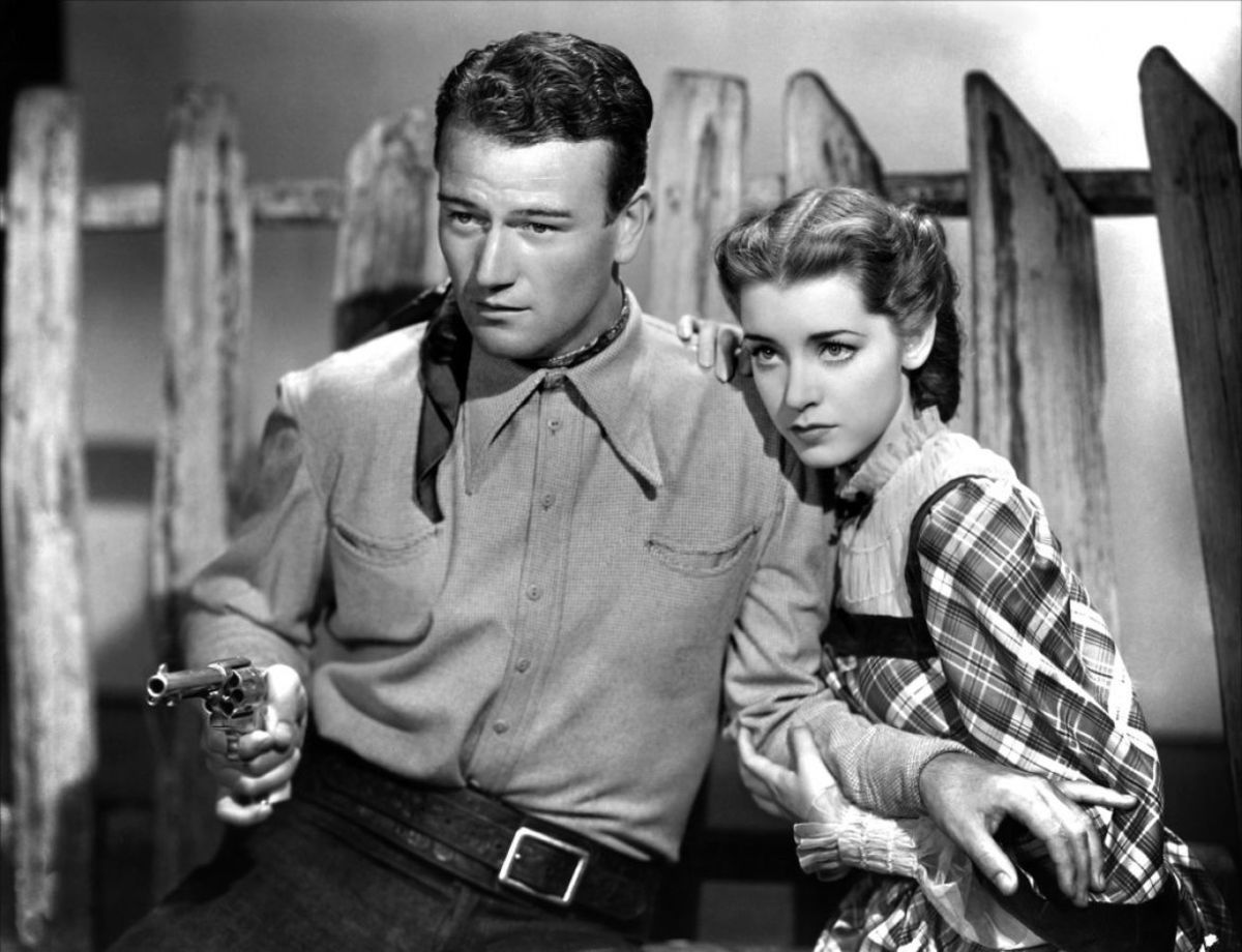 John Wayne & Marsha Hunt in Born to the West aka Hell Town - cropped screenshot - 1937