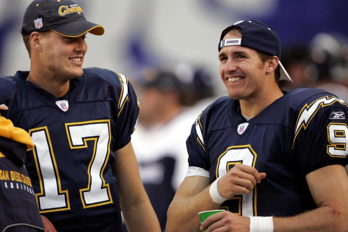 Drew Brees (Right) talking with Philip Rivers (Left)
