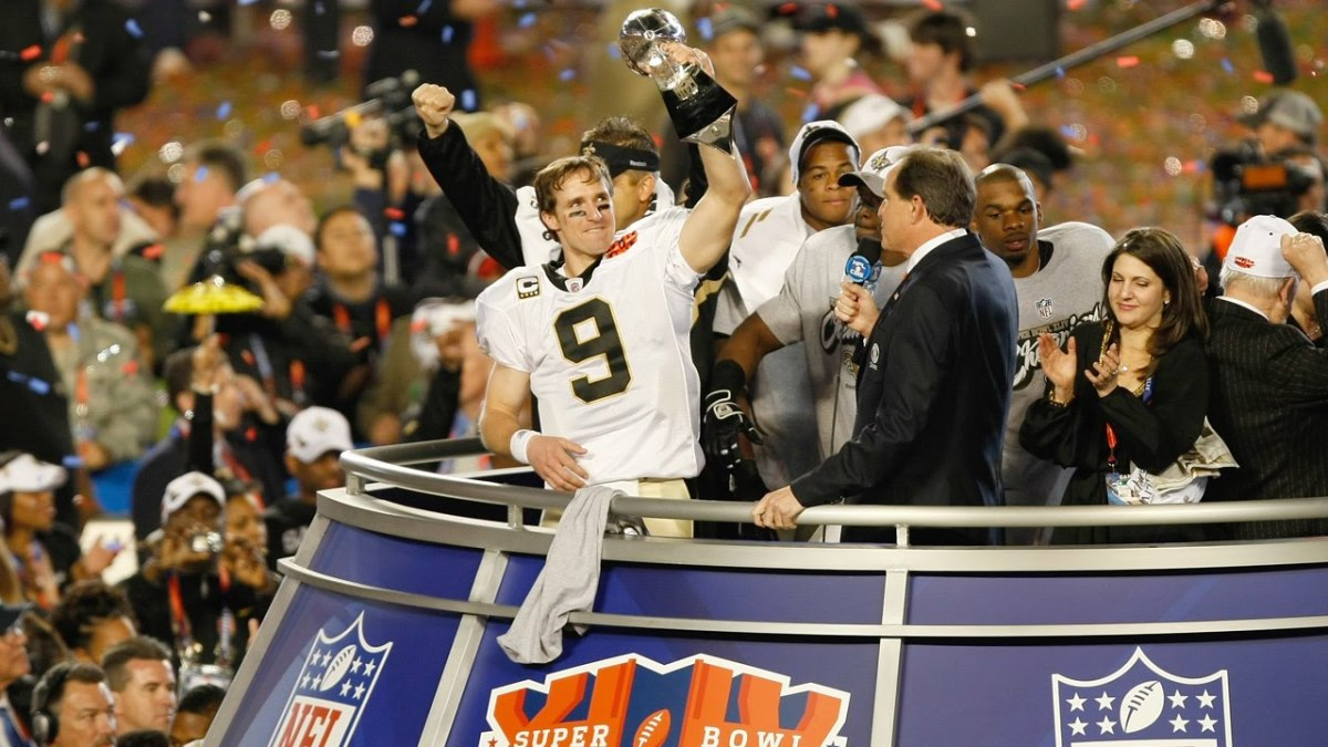 Brees Raises the Lombardi Trophy in 2010 after defeating the Colts.