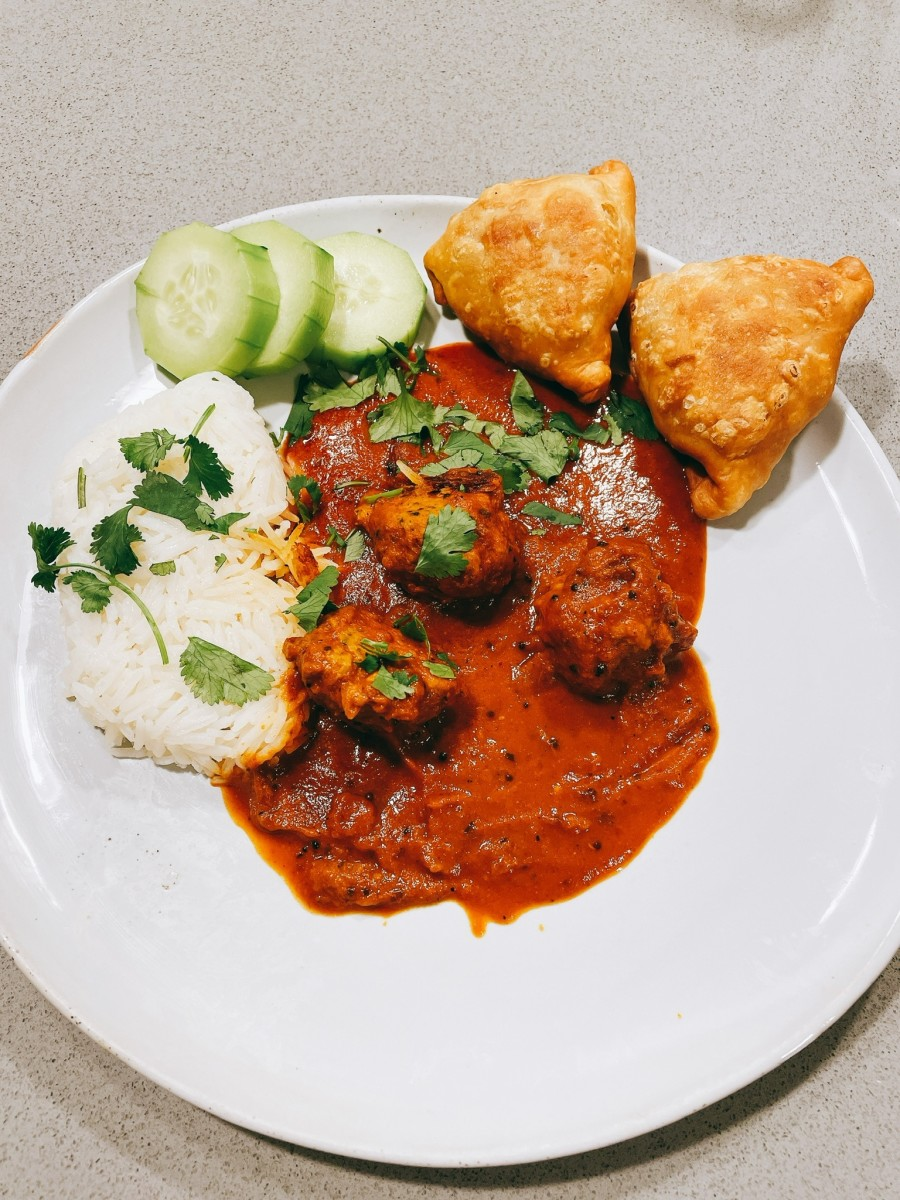 A delicious dinner with homemade samosas on the side
