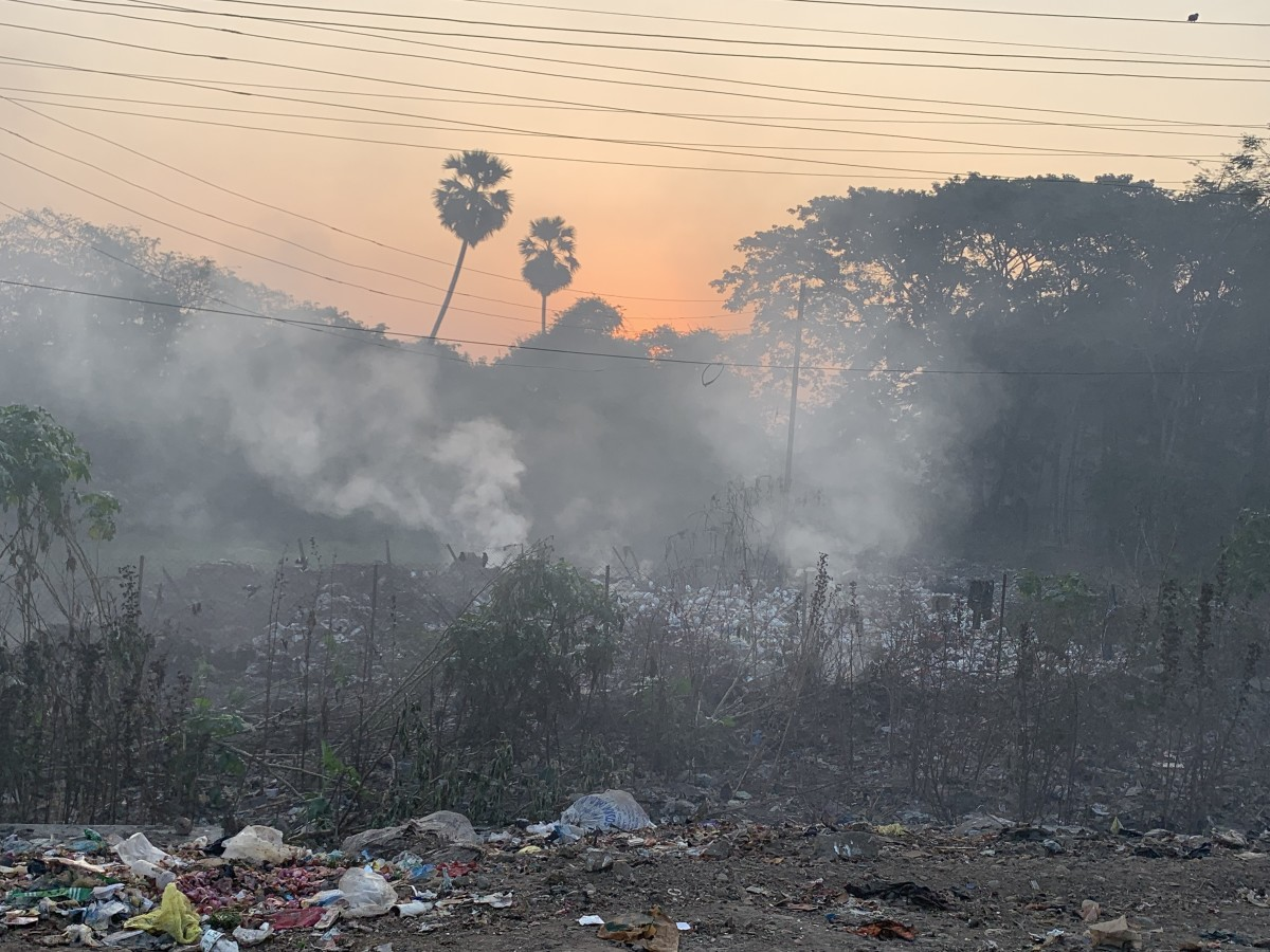 A burning roadside garbage dump at Panvel Naka near Mumbai