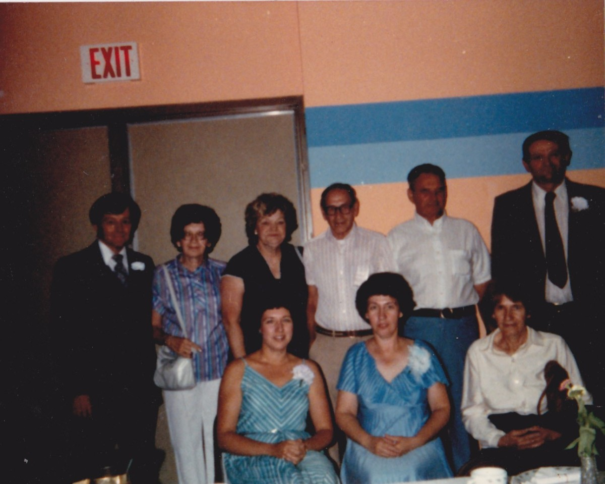 grandma's children and in-laws:  from left to right in back:  Jim Asplin, husband of aunt Mary; aunt Sissy, Dodie Schmidt, wife of uncle Raymie; uncle Raymie; my father; Joe Breu, husband of aunt Donna.  Seated from l-r, aunts Mary, Donna, and mom