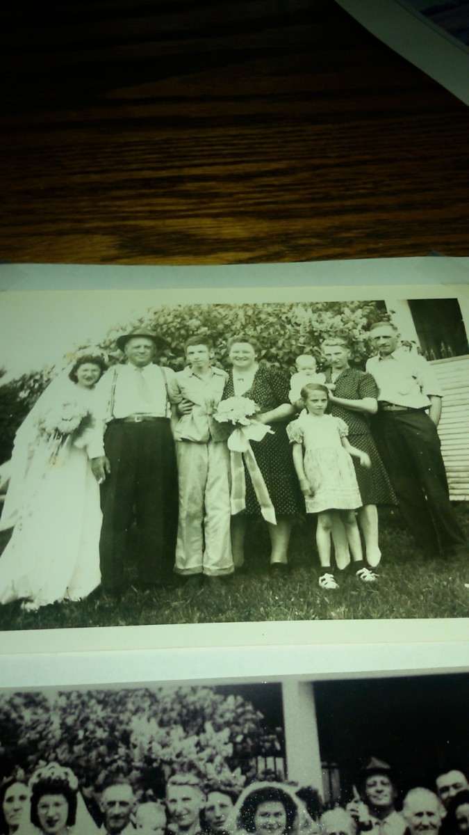 The Schmidt family.  From right to left:  grandpa Schmidt, grandma Schmidt holding aunt Mary, aunt Donna standing in front, unknown woman, uncle Leo, great-uncle Henry Schmidt, and aunt Sissy