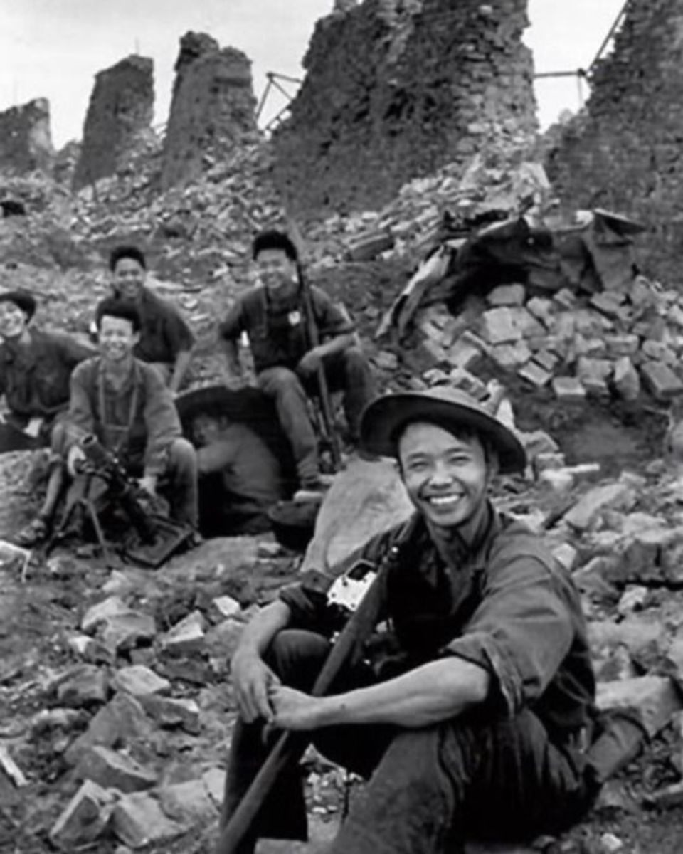 NVA troops take a pause during the battle for the Citadel inside Hue 1968.