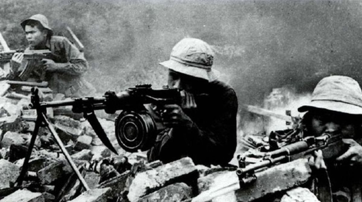 NVA firing at American Marines during the battle for Hue. Around 8,000 NVA regulars or VC insurgents lost their lives in Hue.
