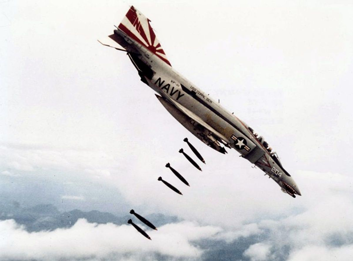 """An American F-48 VF111 bomber in Vietnam. Chief of Staff of the United States Air Force Curtis LeMay stated that """"we're going to bomb them back into the Stone Age""""."""
