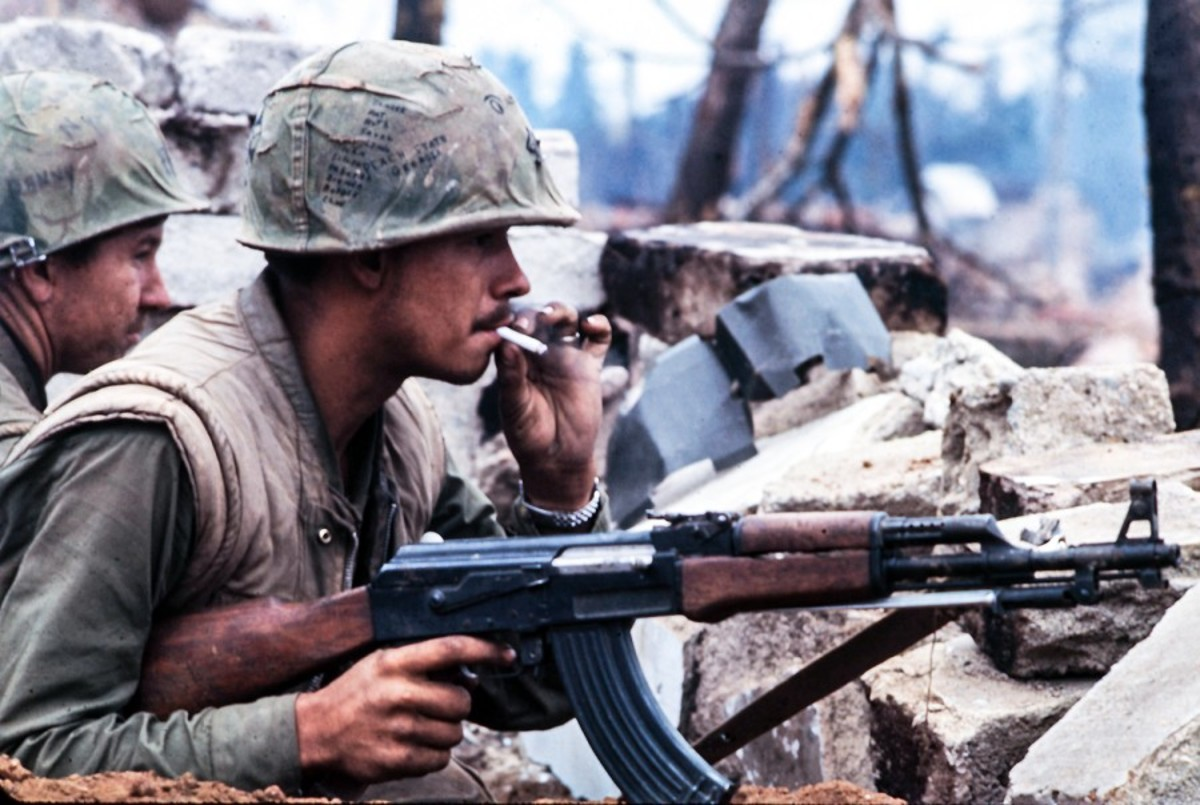 American Marine holds the main battle weapon of the North Vietnamese Army (NVA) the AK-47 during the battle for Hue.
