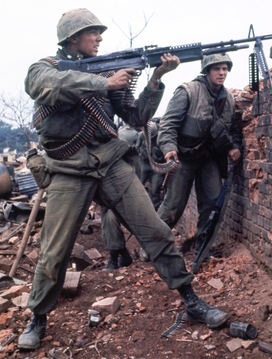 An American Marine firing an M-60 machine gun at NVA inside the Citadel of Hue 1968. The average age for an American infantry man in Vietnam was twenty-one. Over 1700 Americans are still missing over 55 years after the end of the Vietnam War.