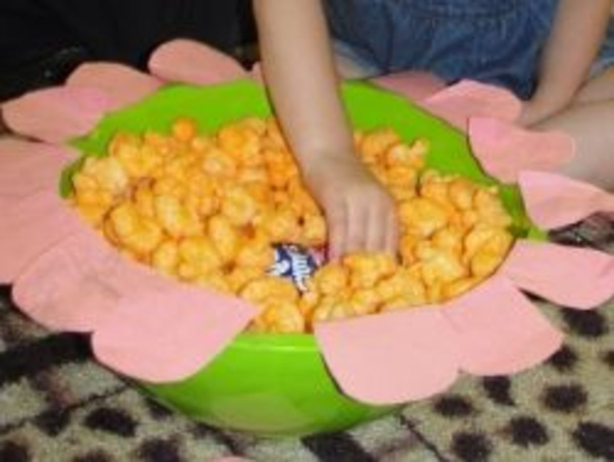 Demonstrating how bees pollinate flowers using cheese puffs and juice boxes