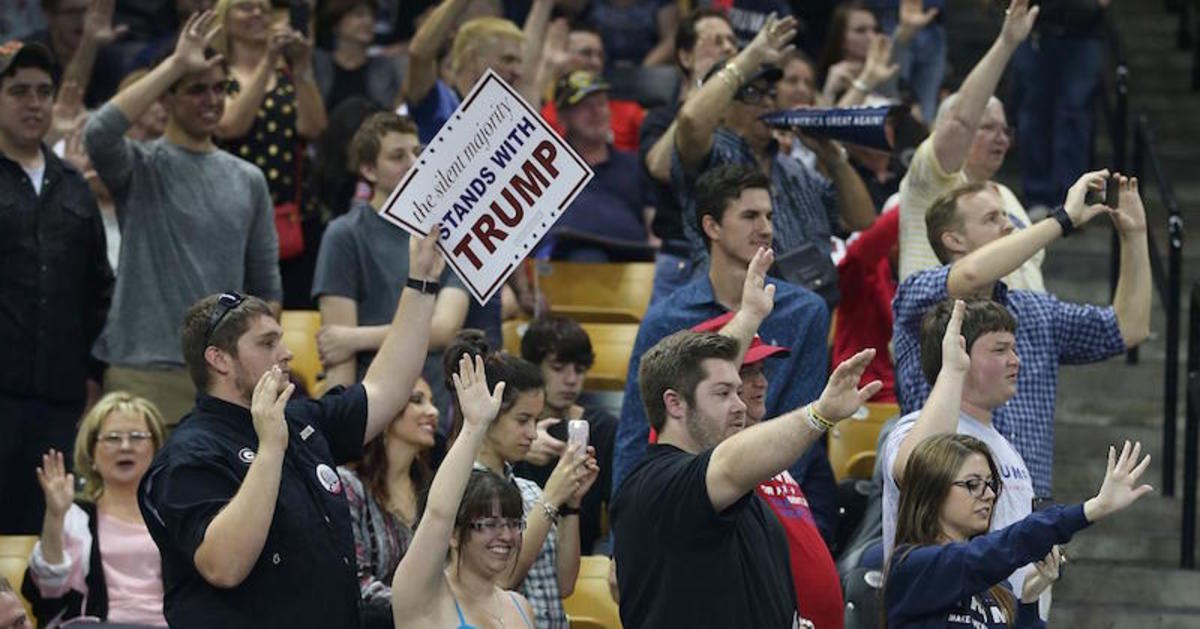 Trump's Followers raising their hands pledging to vote for Trump.. Looked like a German salute of the Third Reich..