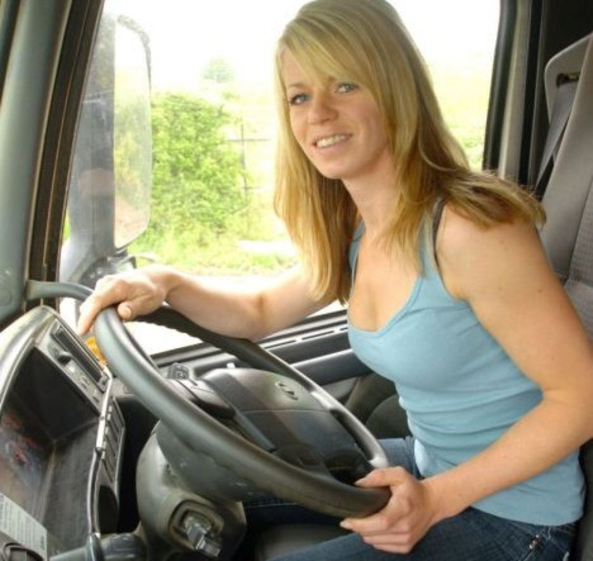 Yes, even the pretty ladies know how to handle a diesel rig as good as any man.