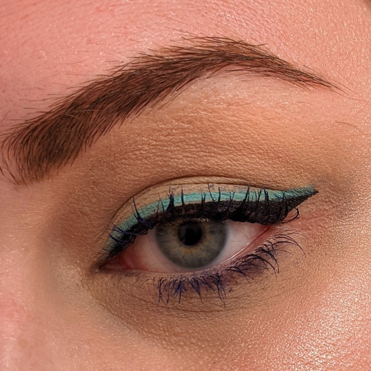 """Double up your liner with Stila Stay All Day Liquid Liner in """"Intense Black"""" and LA Girl Shockwave Neon Eyeliner in """"Fresh."""""""