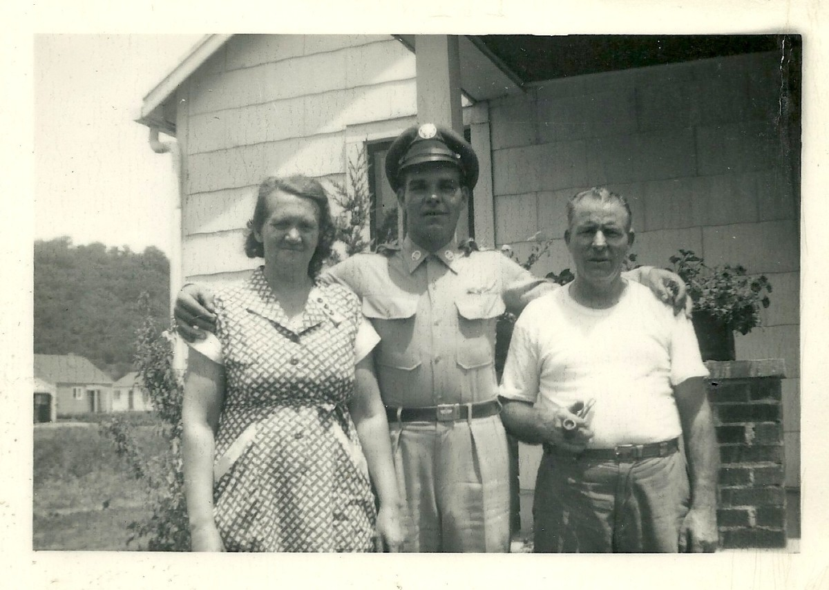 My dad with his parents in the 1950s.
