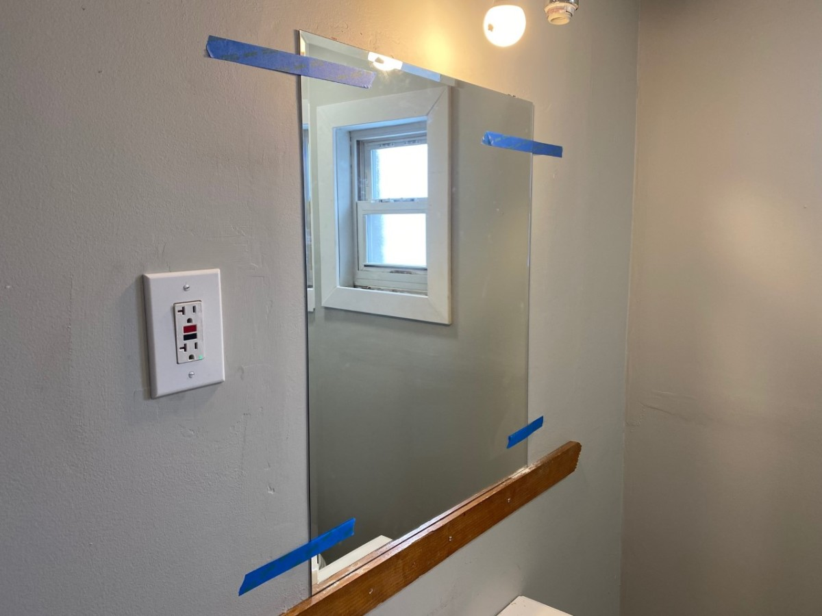 Mirror mounted with painter's tape for additional support